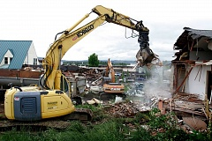 by: OUTLOOK PHOTO: JIM CLARK - Demolition crews begin tearing down buildings on a single block in downtown Troutdale.