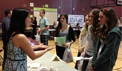by: LORI HALL - City Councilor Jenni Tan talks with Rosemont Ridge Middle School eighth-graders, from left, Katie Watters, Madison Roby, Emmalyn Leonard and Tina Glausa during career day.