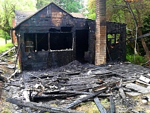 by: OUTLOOK PHOTO: CARI HACHMANN - An accidental fire blackened the back third of a home located in the outskirts of Troutdale.