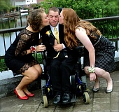 by: SUBMITTED - Adam Goeken is treated to kisses on prom night from his dates, Corrina Winstead, left, and Haley Jensen.