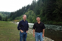 by: ESTACADA NEWS PHOTO: ISABEL GAUTSCHI - Steven Corson of PGEs corporate communications department and biologist Tim Shibahara stand before the newly reonovated Faraday Lake.