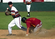 by: DAN BROOD - AT THE BAG -- Tualatin junior second baseman Joey Fishback (left) looks to make a throw to first after forcing out Central Catholic's Charlie Farrenkoph during Monday's state playoff game.