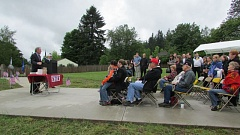 by: SPOTLIGHT PHOTO: ROBIN JOHNSON - Ted Kulongoski addresses the crowd at Veterans Park beside local veteran Frank Weber.