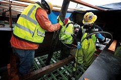 by: TRIBUNE PHOTO: JONATHAN HOUSE - Crews with Kiewit Infrastructure West poured a permanent connection Thursday, March 6, to the west end of the new Portland-to-Milwaukie light-rail bridge. A new connection for the east side of the bridge will be poured in the next few weeks.
