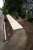 Photo Credit: TRIBUNE PHOTO JAIME VALDEZ - Portland transportation planners hope to end floating sidewalks or sidewalks to nowhere, like this one on Southwest Multnomah Boulevard. Developers are required to build them in front of new infill project, but the city has been waiving the requirement because they dont make much sense. Instead, planners are studying how to pool the money that would other be spent on them and use it for sidewalks that connect to something on higher priority streets.