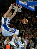 by: SENT TO CANBY HERALD - Clint Chapman puts home a dunk for Fribourg Olympic last season.