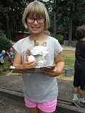 by: SUBMITTED PHOTO - Ella Brodsky shows the contraption she made to help her egg hopefully survive a high drop at Camp Kensington last summer.