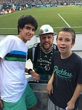 by: SUBMITTED PHOTO - While in Oregon, the Spanish exchange students took in a lot of sights and even made it to a Timbers game. Here, Aitor Guitierrez Gonzales (left) and Ross Pollen pose with Timber Joey at the game last Friday.