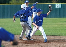 by: THE OUTLOOK: DAVID BALL - Greshams Durham Sundberg hangs onto the ball to collect an out at second base.