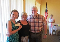 by: BARBARA SHERMAN - GRATEFUL RECIPIENTS - Tara Taylor (left), associate director of community engagements with the Oregon Food Bank, and Jack Schwab, executive director of the Good Neighbor Center in Tigard, accept checks totaling $11,200 from Carol Knutson (center), Summerfield Women's Golf Club's charity event treasurer, at a dinner July 17; in the background is Robin Nash, golf tournament chairwoman, who led the program.