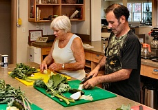 by: DAVID F. ASHTON - Kathleen Randall from Lents, and Alfredo Zavala from Mt. Scott-Arleta, cut vegetables during a Dishing up Portland cooking class held in Woodstocks All Saints Episcopal Church kitchen.