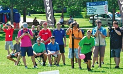 Photo Credit: COURTESY OF PROFESSIONAL DISC GOLF ASSOCIATION - The gallery looks on as Robert Smith fires a shot during a recent major disc golf tournament.