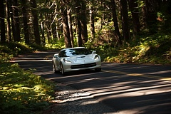 Photo Credit: TRIBUNE PHOTO JOHN M. VINCENT - A Corvette Stingray cruises the Old McKenzie Pass Highway through vibrant forests before crossing lava fields on its way to Sisters.