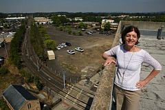 Photo Credit: TIMES PHOTO: JAIME VALDEZ - Cheryl Twete, the city of Beaverton's community development director, stands atop the Beaverton Building with the former Westgate Theater property over her shoulder.