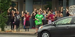 Photo Credit: KOIN 6/ANNIE ELLISON - Peaceful protesters chant, 'Hands Up. Don't Shoot' outside of the Portland Police Bureau's North Precinct.