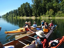 Photo Credit: COURTESY WILLAMETTE RIVERKEEPER - Paddlers stop for a rest and chat on a Paddle Oregon tour of the Willamette River