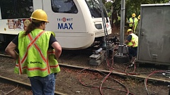Photo Credit: KOIN 6 NEWS - TriMet staff work to repair the MAX line after a train derailed in the Lloyd District on Friday.