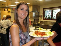 Photo Credit: SUBMITTED PHOTO - WLACC Coordinator Tiffany Carlson gets ready to enjoy her plate of spaghetti at the recent fundraiser.