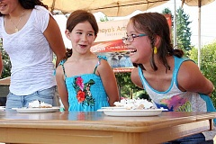 Photo Credit: COURTESY PHOTOS: DIANA WUERTZ - Anela Gaumond (right) prepares for a pie-eating contest at Summer Fest last Sunday while Maggie Schlag looks on.