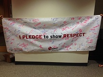 Photo Credit: PORTLAND METRO TOYOTA DEALERS ASSOCIATION - Many signed the Respect banner sponsored by the Portland Metro Toyota Dealers Association at the Bite of Portland to support the Special Olympics.