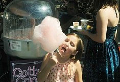 Photo Credit: SETH GORDON - More than a mouthful - Alexandria Jackson enjoys some cotton candy last year at Family Life Church's 'Taste of FLC' outdoor potluck event. The annual celebration will follow the church's outdoor service Sept. 7