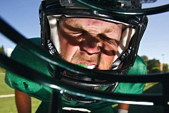 Photo Credit: TRIBUNE PHOTO: JAIME VALDEZ - PSU linebacker Jake Woolley has suffered four concussions in his three seasons at the school and is working with OHSU neuroscientist Laurie King, who is developing objective balance measurements so coaches and trainers will know when a concussed player can return to action.