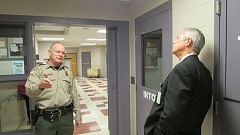 Photo Credit: FILE - Columbia County Sheriff Jeff Dickerson (left) briefs county commissioners (pictured: Tony Hyde, at right) on the condition of the Columbia County Jail last fall. The jail's fiscal situation has improved since then; voters approved a $7.07 million levy to keep the facility from closing this May. But Dickerson says the jail is still struggling not just to hire staff, but to retain them.