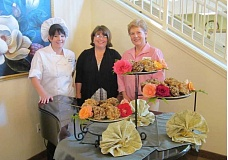 Photo Credit: BARBARA SHERMAN - HAPPY TRIO - Edgewood Point chef Cassandra Walker (left) and Administrator Pepsi LaCamp eye food samples with Expo coordinator Kathy Peper at the assisted living facility.