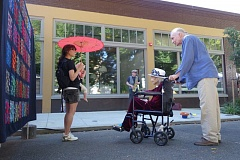 Photo Credit: JOSEPH GALLIVAN - Different generations meet Portland's Art in the Pearl on the North Park blocks Monday, Labor Day.