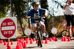 Photo Credit: TIME FILE PHOTO: CHRISTOPHER ONSTOTT - Jadon Ruiz rides through the bike safety rodeo supervised by the Beaverton Police Department during the annual Bike Beaverton event.