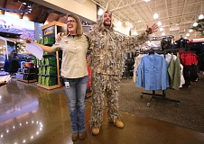 Photo Credit: TIMES PHOTO: JONATHAN HOUSE - Cabela's Marketing Manager Shannon Jidas, left, and 'Camo Guy' Chadd McDowell have some fun during media day at the new store in Tualatin.