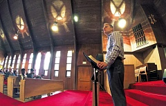 Photo Credit: TRIBUNE PHOTO: JAIME VALDEZ - Pastor Cole Brown, who says he's happy in his job, gives his Sunday morning sermon at Northeast Portlands Emmaus Church. Brown started the inclusive congregation that meets Sundays mornings at Woodlawn Methodist Church.