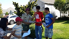 Photo Credit: CONTRIBUTED PHOTO - Westview High School freshman Aditya Jain, third from right, talks to volunteers about distributing fliers related to his beef and dairy industry-related Eagle Scout project.
