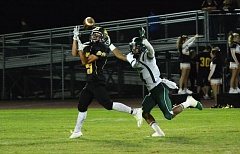 Photo Credit: JOHN WILLIAM HOWARD - St. Helens sophomore Haidon Allen hauls in a pass from sophomore quarterback Levi Norton against Parkrose last Friday night.