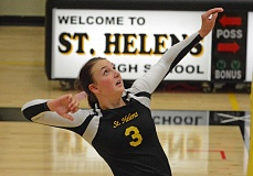 Photo Credit: JOHN WILLIAM HOWARD - St. Helens senior Taylor Albertson takes a swing during the second set of the Lions' 3-0 sweep of Hillsboro on Sept. 9.