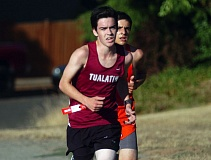 Photo Credit: DAN BROOD - RUNNING STRONG -- Tualatin High School junior Mark French powers his way up a hill during last week's Tualatin Invitational. French finished in eighth place in the race.