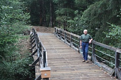 Photo Credit: FILE - Glen Crinklaw stands on the Crown Zellerbach Trail bridge near Scaponia Park on Scappoose-Vernonia Road. Scaponia Park is one of three that will be closed to the public this winter as a cost saving measure.