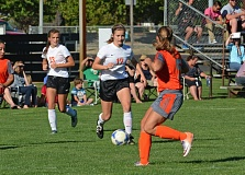 Photo Credit: JOHN WILLIAM HOWARD - Scappoose junior midfielder Lucy Davidson dribbles in space midway through the first half against Gladstone. Davidson's tap-in around Gladstone keeper Molly Webster proved to be the game winner in the third minute.