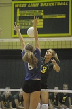 Photo Credit: MATTHEW SHERMAN - West Linn's Kennedy Fulcher hits a ball through the St. Mary's block during last week's league opener. The Lions bested the Blues in straight sets.