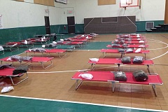 Photo Credit: AMERICAN RED CROSS - The Red Cross currently has 14 evacuees at the shelter opened in conjunction with The First Baptist Church in Estacada. Residents of the Silver Fox RV Park are the primary clients at the shelter. More evacuees might be arriving at the shelter later t his evening.