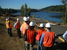 Photo Credit: PHOTO BY: GRADY WHEELER - Milwaukie Parks and Recreation Board members check out construction on the multiuse path that will run through Riverfront Park.