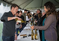 Photo Credit: PHOTO COURTESY ANDREA JOHNSON - Oregon Chardonnay Symposium cofounder Paul Durant pours wine for Stoller Family Estate winemaker Melissa Burr.