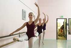 Photo Credit: TIMES PHOTO: JONATHAN HOUSE - Sarah Taylor, Alli MacMillan and Elyssa Adams warm up on the barre at June Taylor's School of Dance prior to their trip to an international dance competition in Belgium.