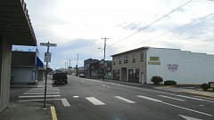 Photo Credit: MARK MILLER - The Houlton district of St. Helens, looking east along Columbia Boulevard at the intersection of North 21st Street. Houlton has historically been a commercial area, but while many businesses continue to thrive in the neighborhood, there are a number of vacant storefronts and available retail space.