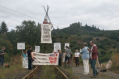 Photo Credit: COURTESY OF PORTLAND RISING TIDE - Demonstrators, including Sunny Glover, chained to a makeshift metal tripod, block railroad tracks at the Port Westward industrial park in a protest against crude oil trains Thursday, Sept. 18. The protest, which was spearheaded by activist group Portland Rising Tide, was cleared shortly before midnight.