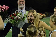 Photo Credit: REVIEW PHOTO: VERN UYETAKE - Morgan Wise celebrates when she learns she's the homecoming queen at halftime during the Friday football game.