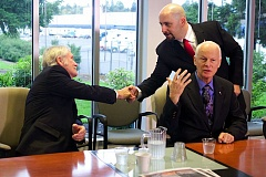 Photo Credit: TRIBUNE PHOTO: JAIME VALDEZ - Pacific Green Party gubernatorial candidate shakes hands with his Democratic rival, Gov. John Kitzhaber and Republican state Rep. Dennis Richardson, during a Sept. 22 joint appearance at the Pamplin Media Group offices in Portland. The former Beaverton teacher made a surprise entry into the newspaper's offices to take part in the joint appearance.
