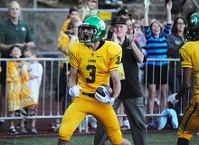 Photo Credit: MATTHEW SHERMAN - Connor Berggren celebrates after scoring West Linn's first touchdown on its opening drive. Berggren would catch three touchdown passes from quarterback Tim Tawa in the 20-6 win.
