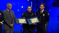 Photo Credit: KOIN 6 NEWS - Portland Police Officer John Romero accepting his awards Thursday.