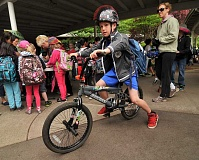 Photo Credit: REVIEW FILE PHOTO: VERN UYETAKE - In May 2013, Lake Grove third-grader Finn McAuley rides his bike in style to school during the Walk + Bike to School Challenge.